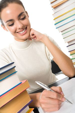 Writing woman with textbooks, isolated on white Stock Photo - 4666278
