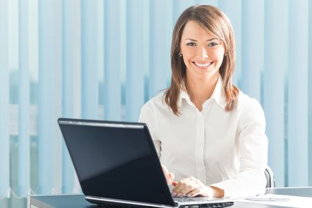 20 25: Happy smiling businesswoman with laptop at office