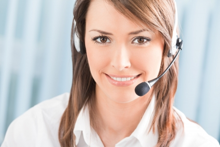 phone operator: Portrait of happy support phone operator in headset at workplace Stock Photo