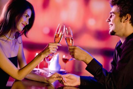 Amorous couple on romantic date or celebrating together at restaurant photo