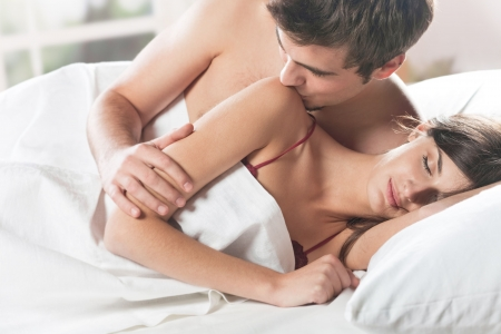 Young attractive happy amorous couple at bedroom Stock Photo - 4794062