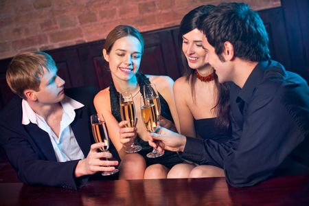 horizontal bar: Two amorous couples celebrating together at restaurant