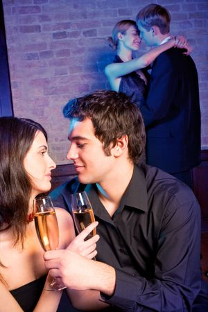 Two amorous couples celebrating together at restaurant Stock Photo - 4794088