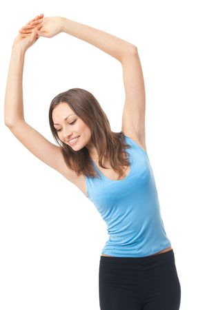 Young happy woman doing exercises or dancing, isolated on white Stock Photo - 4833613