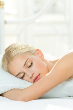 Photo of sleeping young woman at home Stock Photo
