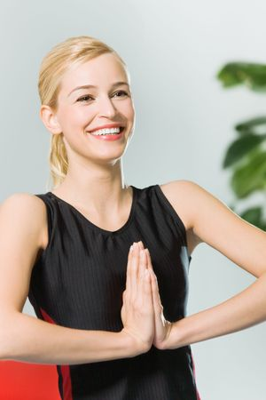 Young woman doing yoga moves, or meditating at home Stock Photo - 5028592