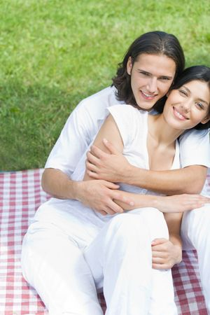 Young happy amorous couple together, outdoors photo