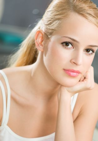 Photo of thoughtful young woman at home  photo