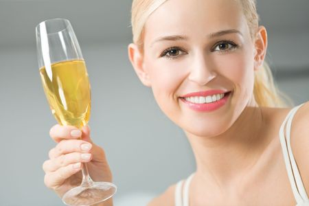 Young happy smiling woman with glass of champagne photo