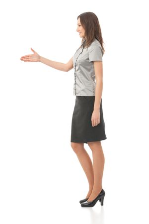 Full body portrait of businesswoman giving hand for handshake, isolated on white photo