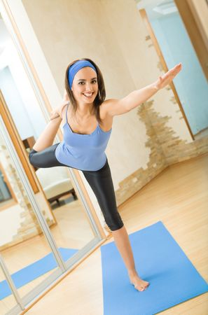 Young happy woman exercising at home Stock Photo - 5484260