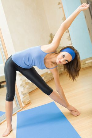 Young happy woman exercising at home Stock Photo - 5484262
