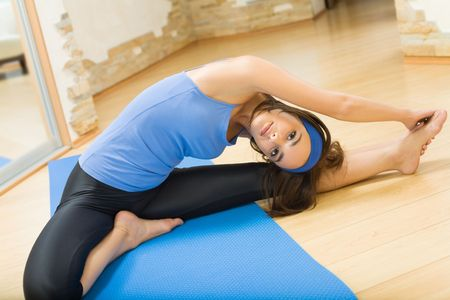 Young happy woman exercising at home Stock Photo - 5484266