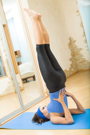 Young happy woman exercising at home photo
