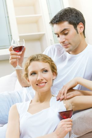 Young couple celebrating with red wine at home Stock Photo - 5530518