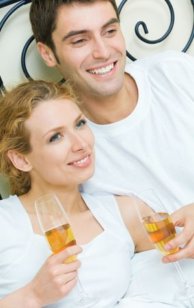 Young couple celebrating with champagne at bedroom Stock Photo - 5530509
