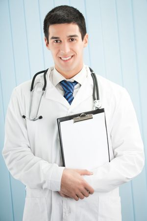 Happy doctor with clipboard at office Stock Photo - 5568853