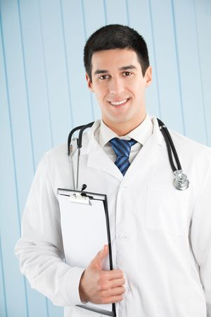 Happy doctor with clipboard at office Stock Photo - 5568860