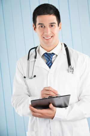 Happy doctor with pen and clipboard at office Stock Photo - 5568884