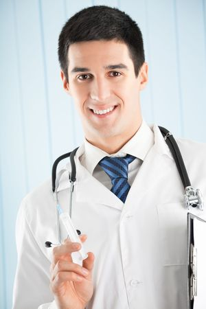 Happy doctor with syringe and clipboard at office photo