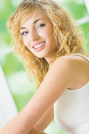 Young happy smiling attractive woman in lingerie at bedroom photo