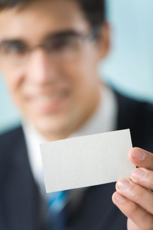 Happy businessman showing business card at office photo