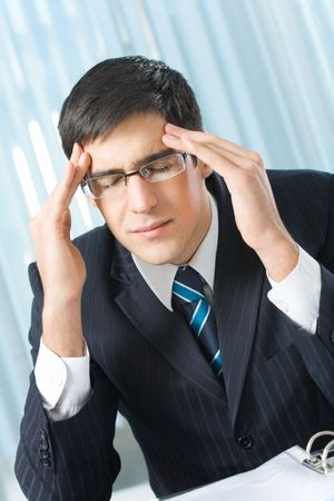 Tired or ill businessman at office Stock Photo - 5724189