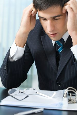 Tired or ill businessman at office Stock Photo - 5724204