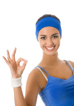 sports wear: Young happy woman in sports wear gesturing, isolated on white