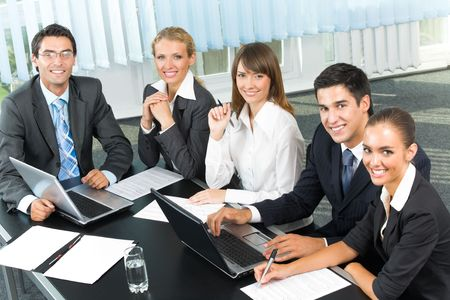 businessteam: Successful business-team planning or brainstorming at office Stock Photo