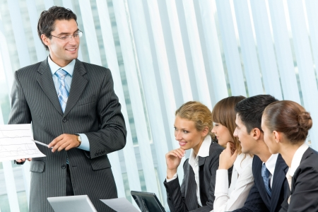 speaker: Business people at business meeting, seminar or conference