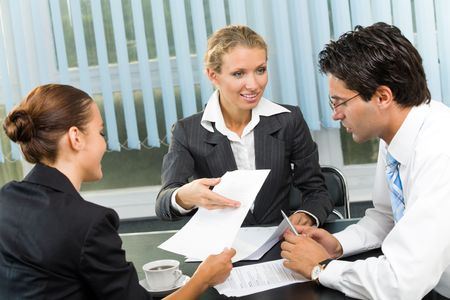 businessman signing documents: Successful business team working together at office