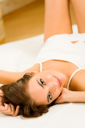bed time: Young happy smiling woman waking up at bedroom