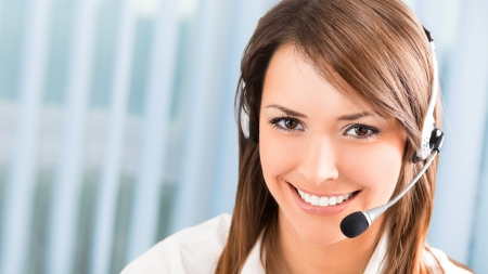 Support phone operator in headset at workplace. To provide maximum quality, I have made this image, by combination of two photos. Stock Photo - 6965565
