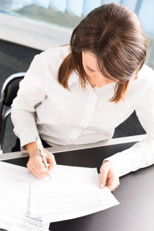 Happy smiling businesswoman with document at office photo