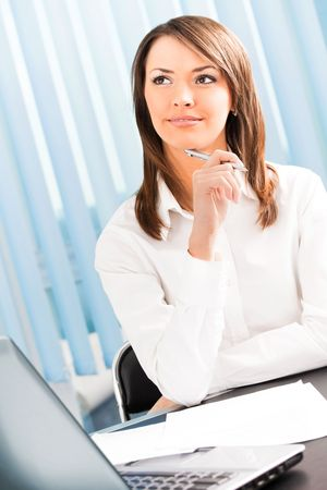 Thinking or dreaming businesswoman with pen at office photo
