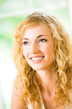 Portrait of young attractive smiling woman at home photo