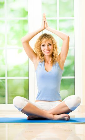 Young happy woman exercising at home Stock Photo - 7123119
