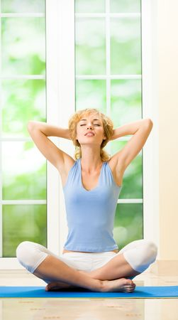 Young happy woman exercising at home Stock Photo - 7123121