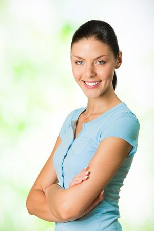 Portrait of young attractive smiling woman, outdoor Stock Photo - 7268973