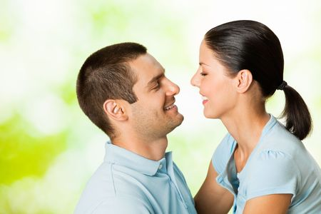 Young happy smiling attractive couple, outdoors photo
