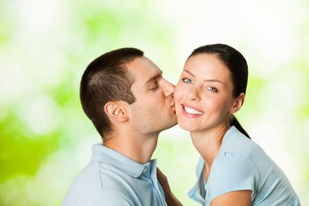 Young happy attractive couple, outdoors photo
