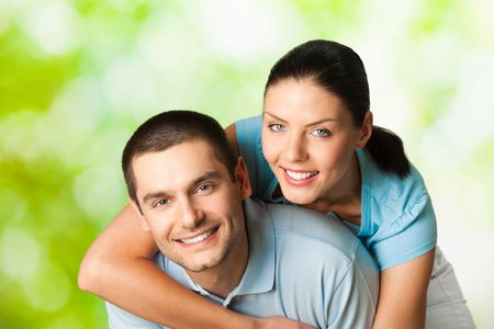 Young happy smiling attractive couple, outdoors Stock Photo - 7297974