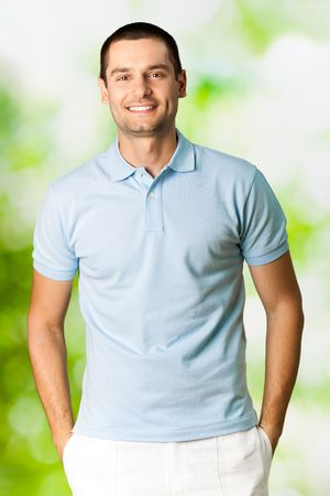 Portrait of young attractive smiling man, outdoors Stock Photo - 7354810