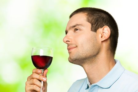 redwine: Young man with glass of redwine, outdoors