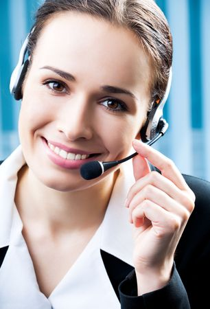 Support phone operator in headset at workplace Stock Photo - 7486612