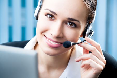 Support phone operator in headset at workplace Stock Photo - 7486586