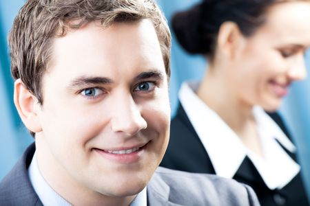 Portrait of successful businessman and colleague on background, at office photo