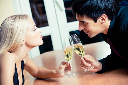 Couple on romantic date or celebrating together at restaurant photo