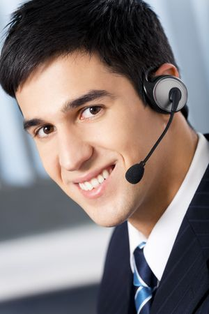 handsfree telephone: Support phone operator in headset at workplace Stock Photo